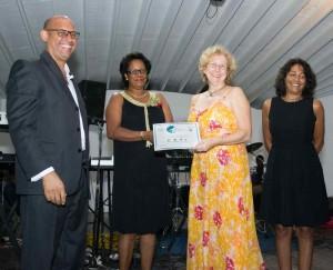 Gerlinde Seupel, Aquanauts Grenada accepting Award from the Hon. Yoland Bain Hosford