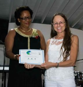 Johanna Kostka from Sunsation Tours accepting Award from the Hon. Yoland Bain Hosford