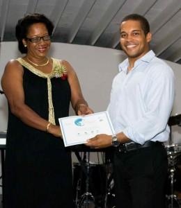 Zack Samuel, Calabash Hotel receiving Award from the Hon. Yoland Bain Hosford