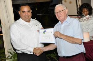 Lieutenant Governor of Bonaire Mr Edison Rijna presenting Jon Klos Dive Friends Bonaire with Skyviews Sustainability Award